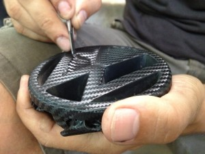 Wrapping in carbon fiber some Golf MK1 car parts.